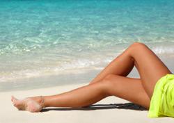 Beine am Strand